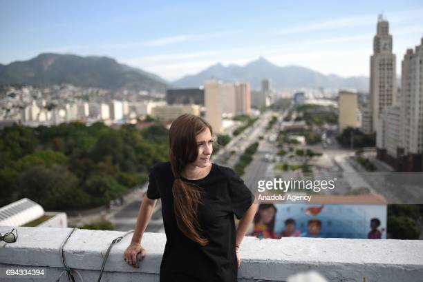 19yearsold graphic artist Luna Buschinelli poses at the top of a building which is close to her mural that painted on the facade of the Rivadavia...