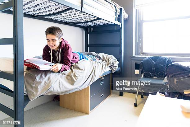 19-years-old student girl in the campus's dormitory  room - petite teen girl stock photos and pictures
