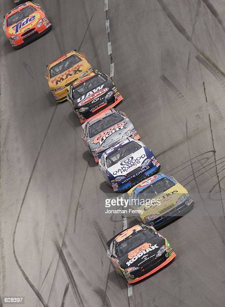 Stacy Compton in the Melling Racing Dodge Intrepid leads a pack followed by John Andretti's Petty Enterprises Dodge Intrepid during the NASCAR...