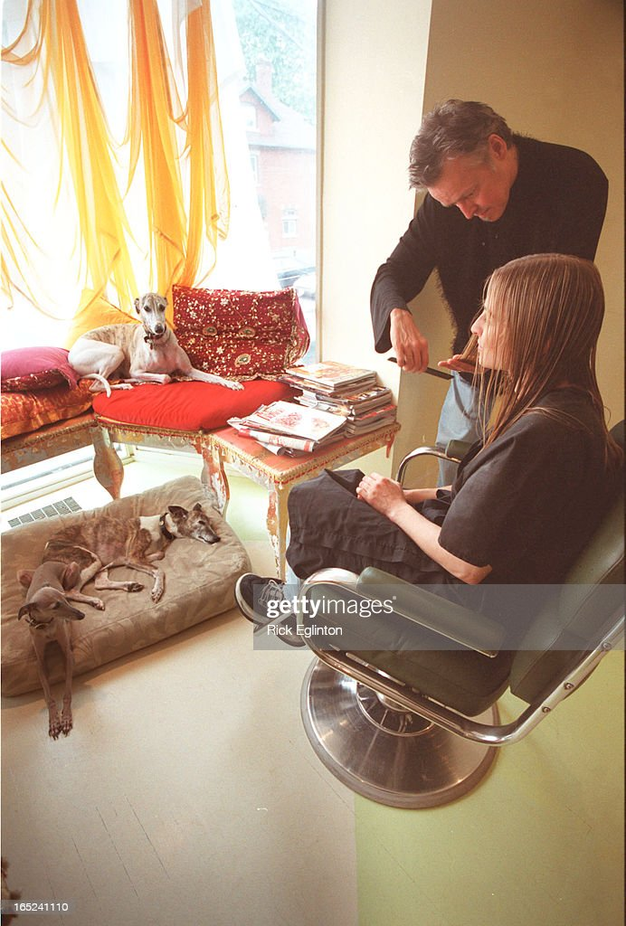 1.Denis Bouchard (Hairdresser) shown with client Adrienne Annau of T.O. during session in his shop w : News Photo