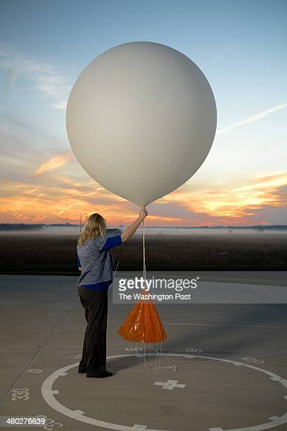 Meteorologist Carrie Suffern Prepares to Release the Weather Balloon at National Weather Service Headquarters on October 1 2012 in Sterling Virginia