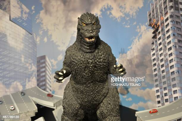 A 1metre tall statue of Godzilla is displayed at a Godzilla art exhibition in Tokyo on May 2 2014 Japanese fans of Godzilla say the newlyunveiled...