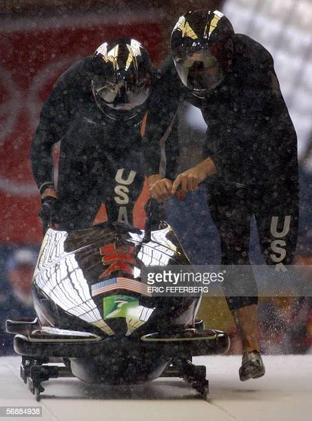 USA 1of Todd Hays and Pavle Jovanovic push their bob at the start of the third run of the twoman bobsleigh event at the Turin 2006 Winter Olympics in...