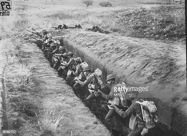 1st African American Division in training in Arizona take aim from a slit trench
