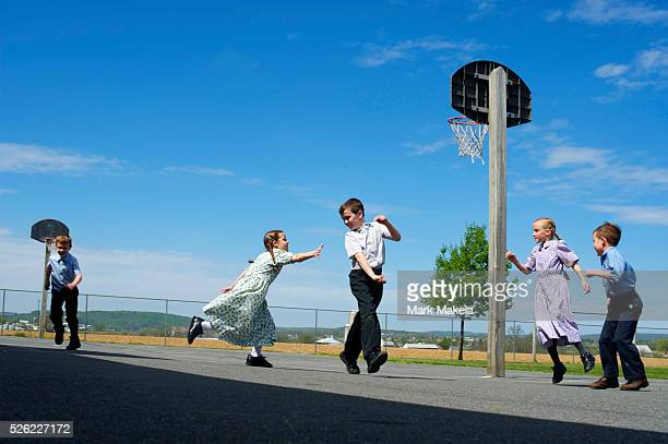 1st and 2nd graders from Crossroad Mennonite School play during recess on April 17 2012 in New Holland PA Former Massachusetts Gov Mitt Romney a...