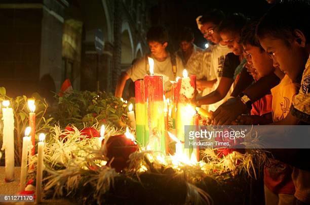 26/11 1st Anniversary Candle Light People places a candle outside the Taj Mahal hotel one of the sites of the terrorist attacks on the first...