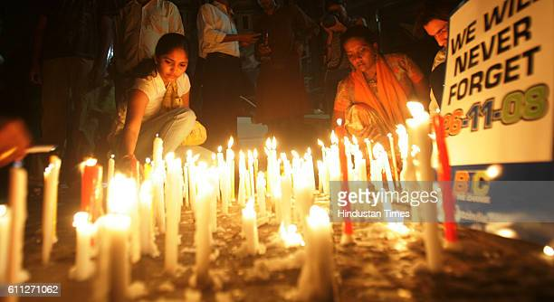 26/11 1st Anniversary Candle Light Women places a candle outside the Taj Mahal hotel one of the sites of the terrorist attacks on the first...
