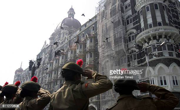 26/11 1st Anniversary NCC Cadets from Kirti College salutes the victims killed inside the Taj Mahal hotel one of the sites of Mumbai terror attacks...