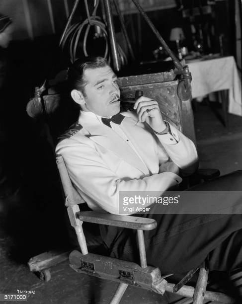 Clark Gable takes a break from his role as ship's captain Alan Gaskell in 'China Seas' directed by Tay Garnett