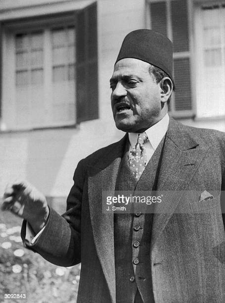 Egyptian politician Nahas Pasha, a former prime minister and head of the Egyptian nationalist Wafd party at his home in Heliopolis, Cairo. He is...