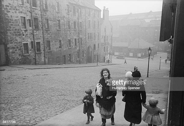 Mothers and their children walking up Balmano Brae to Rotten Row in a poor area of Glasgow Glasgow began an ambitious housing plan in 1919 when it...