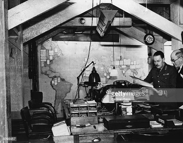 The designers of the cabinet war room under Whitehall, London, L C Hollis and L F Burgis look over their creation.