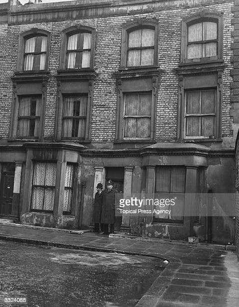 Police guarding 10 Rillington Place home of murderer John Reginald Halliday Christie where the remains of his wife and three other women were found