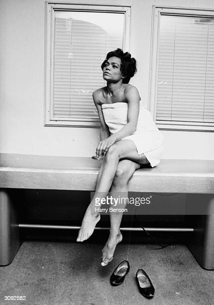 American singer Eartha Kitt wrapped in a towel at the Town and Country Health Salon in Knightsbridge London