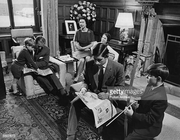 The Royal Family relaxing in a drawing room at Sandringham House Norfolk Prince Edward Prince Philip Duke of Edinburgh Queen Elizabeth II Princess...