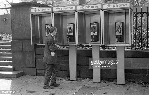A man approaches a row of pay phones near Bryant park in midtown Manhattan New York