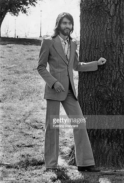 Model wearing a flared trouser suit.