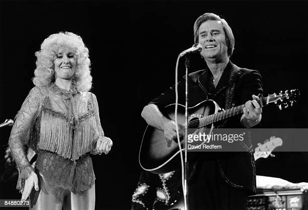 Country Artists Tammy Wynette and George Jones perform live on stage at the Country Music Festival Wembley Arena London in April 1981