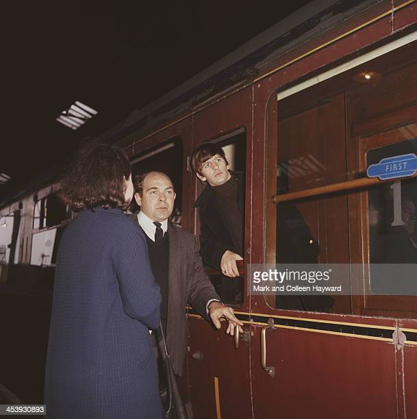 Ringo Starr leans out of a carriage window at Marylebone Station in London during the filming of 'A Hard Day's Night' in April 1964