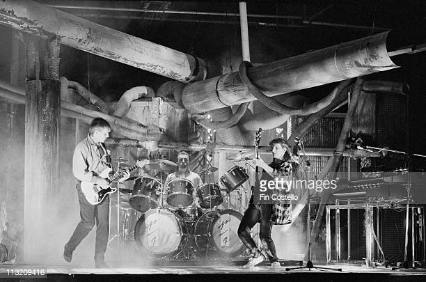 Rush perform on a video shoot in Battersea London in April 1984 Left to Right Alex Lifeson Neil Peart Geddy Lee