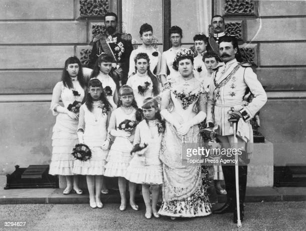 Princess Beatrice the youngest daughter of Queen Victoria and Prince Albert and Prince Henry of Battenberg on their wedding day with their bridesmaids