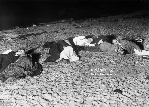 Men sleeping on the sands at Westcliff during a heatwave