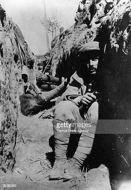 French soldiers protect themselves from shrapnel in a dugout.