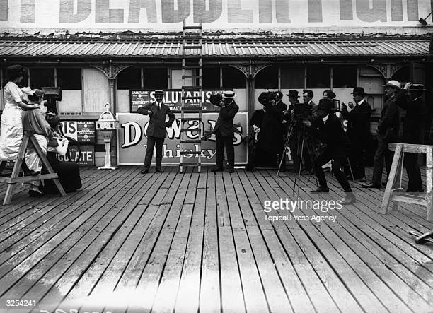 The winners of an international beauty contest pose for press photographers on the pier at Folkestone