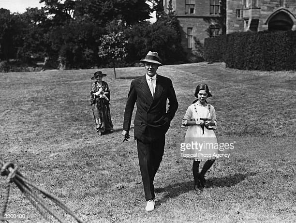 The 2nd Duke of Westminster Hugh Richard Arthur Grosvenor 1879 1953 seen here with his second daughter at a presentation ceremony