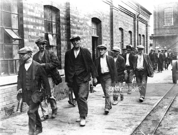 Miners from the colliery at Crown Farm near Mansfield Nottingham on their way home from work