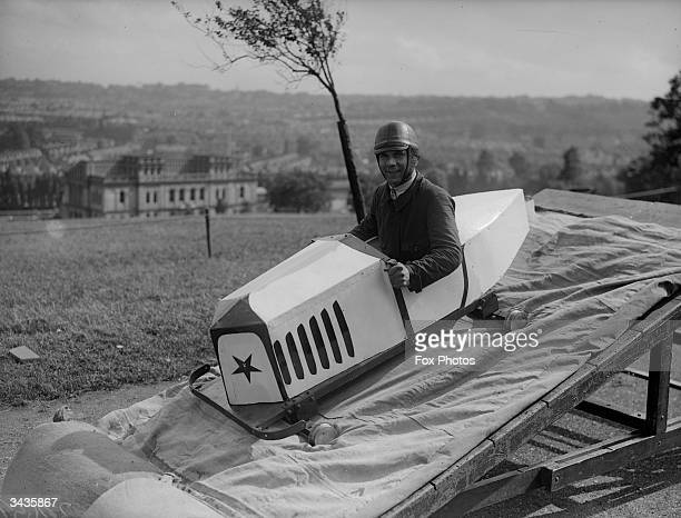 A stuntman lands on a safety mattress in a customised plane at Alexandra Palace in London