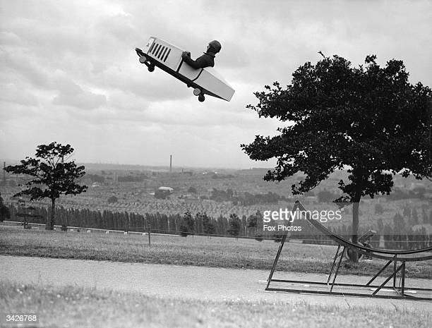 A stuntman takes off in a customised plane at Alexandra Palace in London