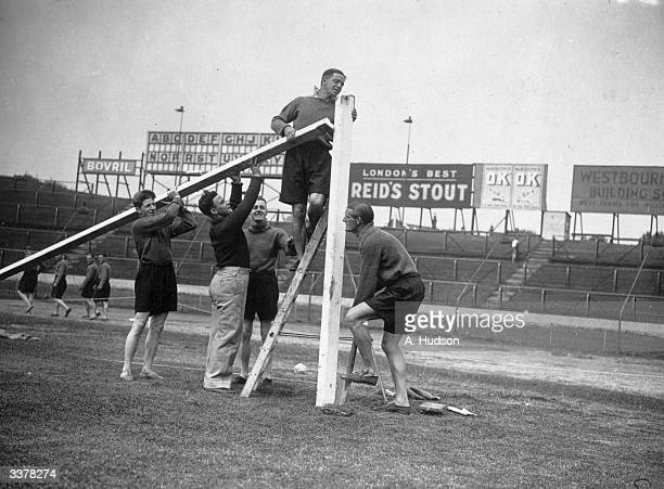 Chelsea Football Club players report for training at Stamford Bridge where their first duty is to erect the goal posts