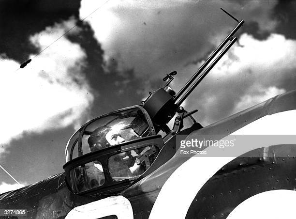 A bomber's gunner in his turret during practice at an RAF station 'somewhere in England'