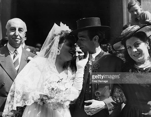 Austin Garcia, one of the stars of the Gay Spanish Gypsies of Carmen Amaya, with his bride Veronica Parmigiana who holds a coin as a symbol of luck,...