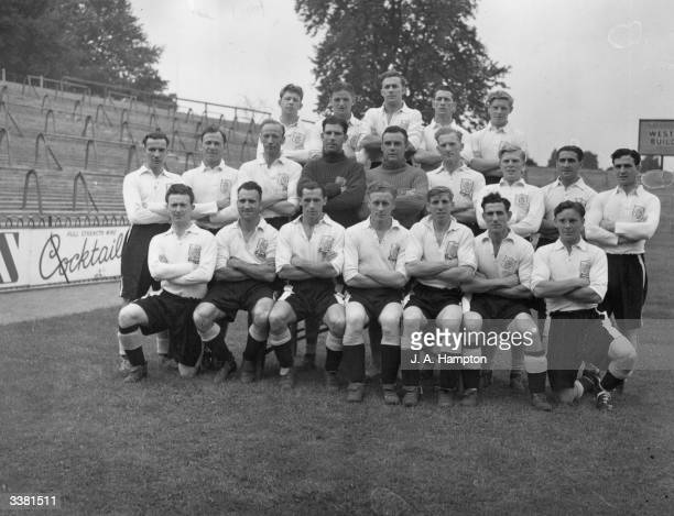 The players of Fulham Football Club from left to right starting from the back row B Brown W Hinchlewood E Lowe T Harris R Dwight H Freeman N Smith W...