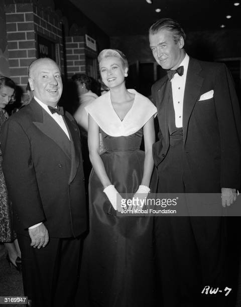 British director Alfred Hitchcock with Grace Kelly and James Stewart the stars of his latest thriller 'Rear Window' at the film's premiere