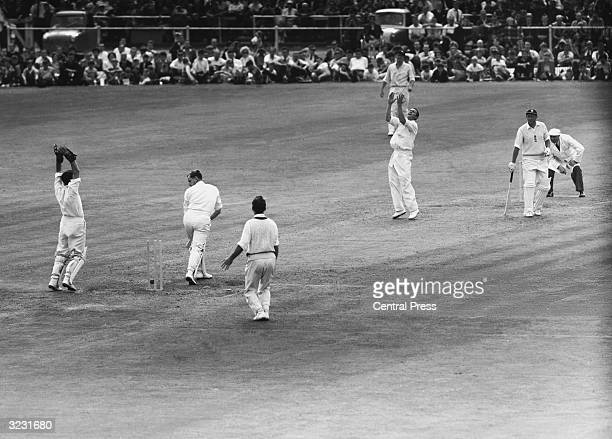CHECK HIRES IF SUPPLYING DIGITALLY England captain Peter May looks on at his stumps in disbelief as he is bowled by Richie Benaud during England's...