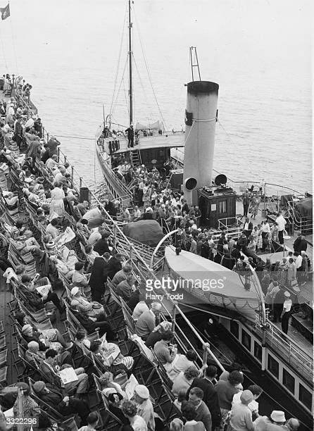 People disembark from the paddle steamer 'Medway Queen' at South End On Sea
