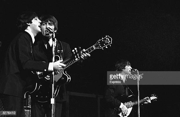 The Beatles from left to right Paul McCartney George Harrison and John Lennon in concert in America