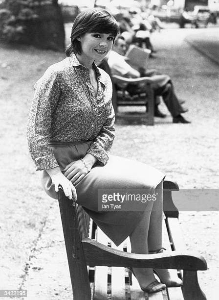 Irish Eurovision Song Contest winner Dana formerly Rosemary Brown sitting on a bench in Berkeley Square London