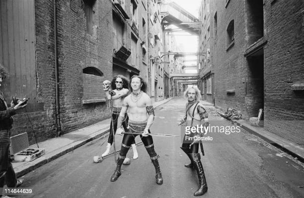 English Heavy Metal band Venom posed in Shad Thames in London in August 1984 Left to Right drummer Anthony 'Abaddon' Bray bassist Conrad 'Cronos'...