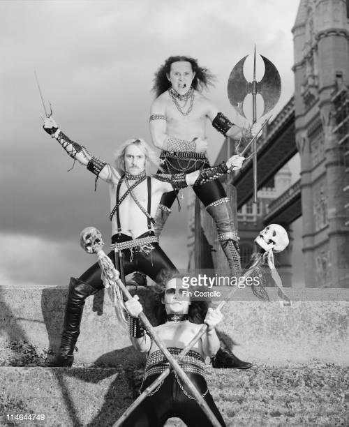 English heavy metal band Venom posed with weapons in front of Tower bridge in London in August 1984. Top to Bottom: bassist Conrad 'Cronos' Lant,...