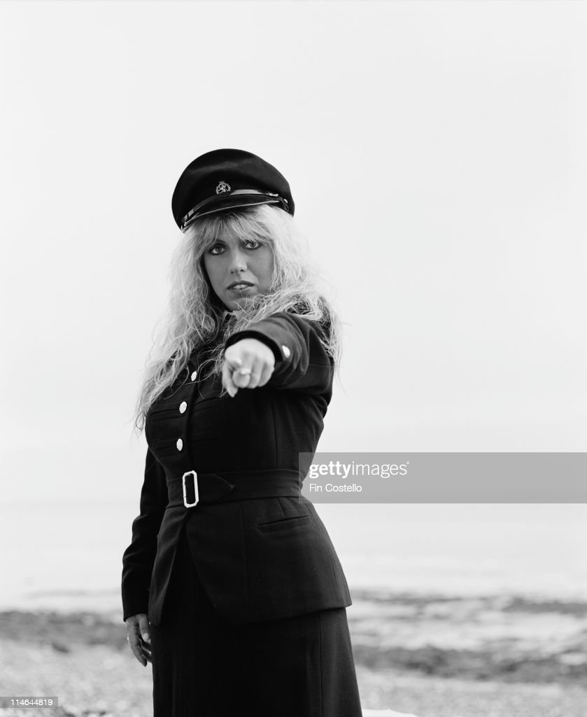 English singer and songwriter Judie Tzuke posed wearing a military style uniform on the Sussex coast in England in August 1984.