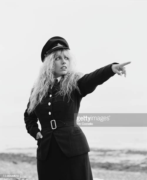 English singer and songwriter Judie Tzuke posed wearing a military style uniform on the Sussex coast in England in August 1984