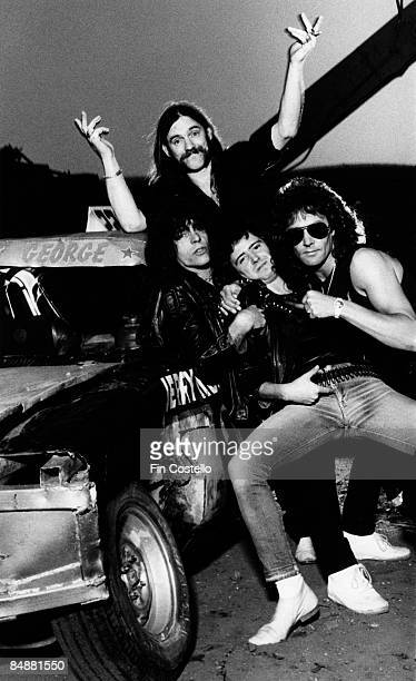 Photo of LEMMY and MOTORHEAD Motorhead posed together in a scrapyard in Pimlico London in August 1984 Clockwise from top Lemmy Kilmister Pete Gill...