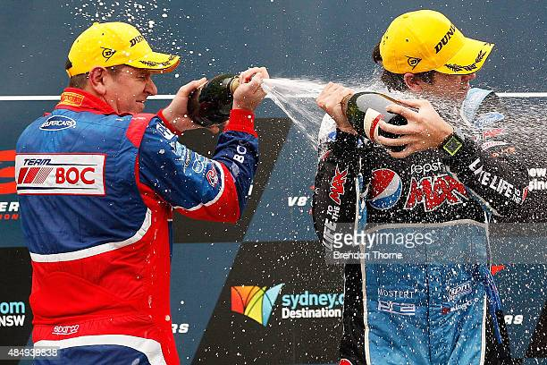 1st Chaz Mostert driver of the Pepsi Max Crew Ford and 3rd Jason Bright driver of the Team BOC Holden celebrate with champagne atop the podium...