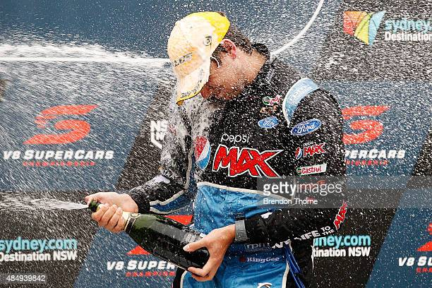 1st Chaz Mostert driver of the Pepsi Max Crew Ford celebrates with champagne atop the podium following race 23 for the V8 Supercars Sydney Motorsport...