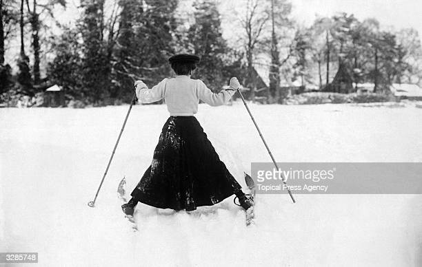 A woman having a little difficulty controlling her skis in the snow at Northampton