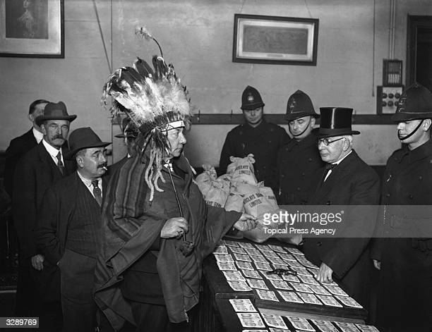 Sir George Royle president of the New Tabernacle Sick and Provident Society dressed as Native American Iroquois Indian Chief Sunshine receives the...